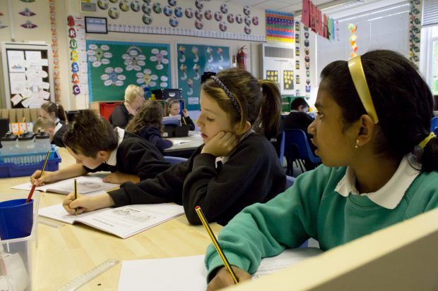 pupils sat at desks in a classroom