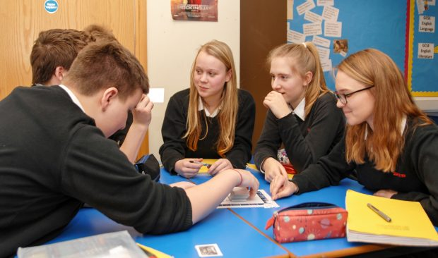 Group of secondary school pupils discussing something.