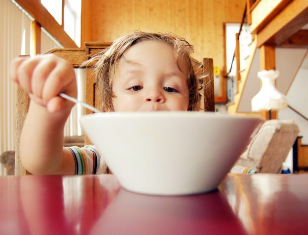 A child eating from a bowl.