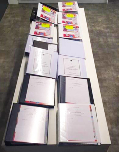 Binders full of evidence found by inspectors.