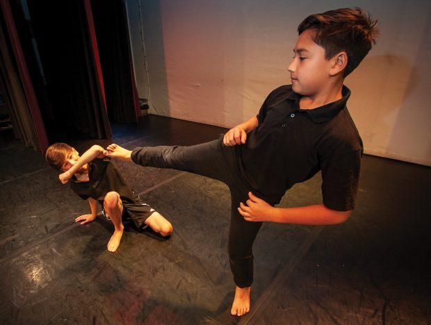Two boys dancing in a studio.