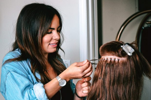 Teenager practising hairdressing on a model
